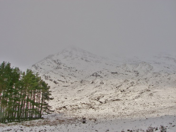Snow lying down to the road and arduous walking into the coire.