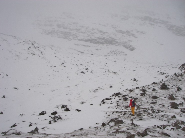 Significant drifting in the coire but exposed ridges remain clear.