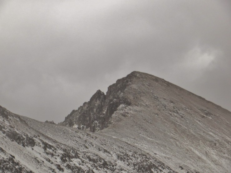 Ridges and tops are scoured clear of snow.