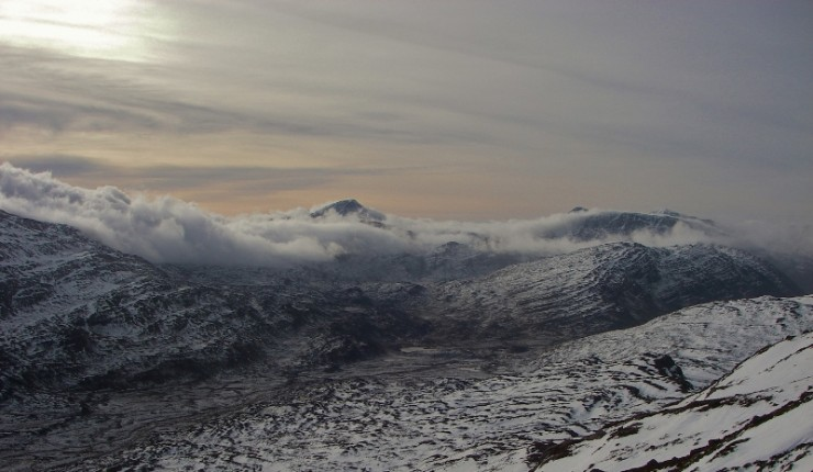 Cold moist clouds moving around Maol Chean-dearg on fresh NW winds.