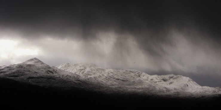 Slow moving snow showers over the Achnashellach hills.