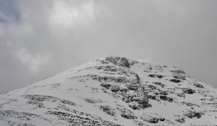 North side of Meall a Ghuithais with large cornice and ice re-forming