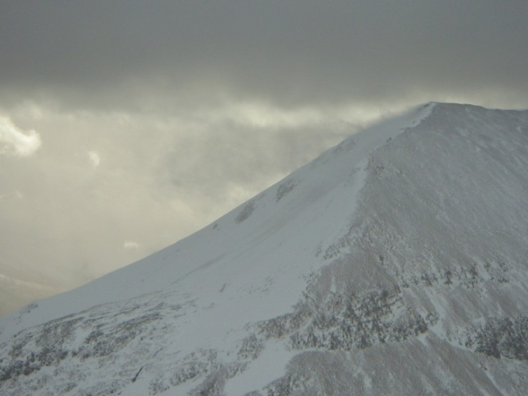 Spindrift blowing 100's of metres out off the summits ahead of a shower.