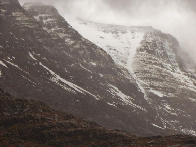 A grim view of Liathach, with the snow level rising in the mild temperatures.
