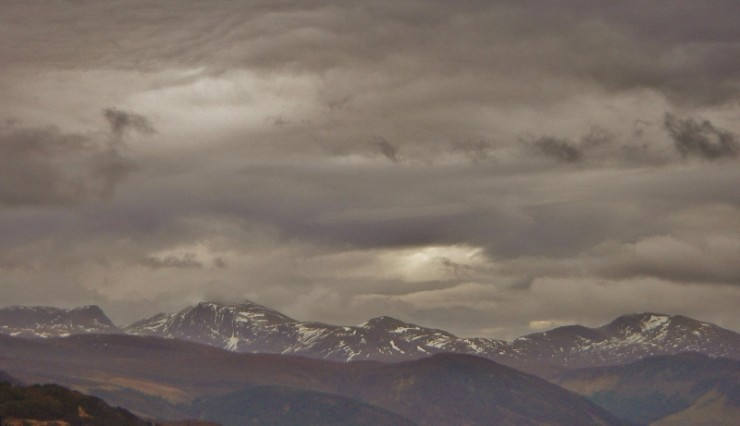 The Beinn Dearg mountains with an ominous cloudscape and diminishing snowpack.
