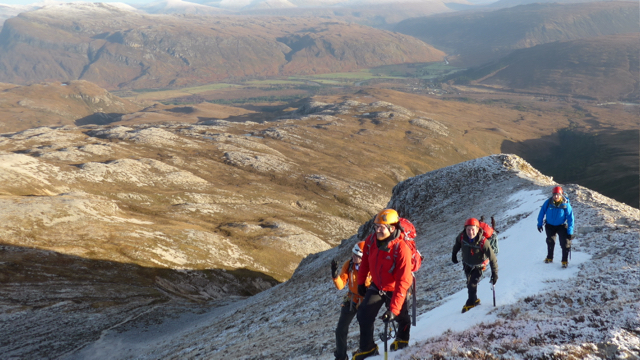 A party showing good crampon work ascending Sgurr Ban, with Kinlochewe below.