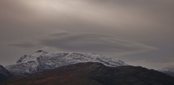 Lenticular cloud cap on Ben Damph - winds due to increase in strength overnight.