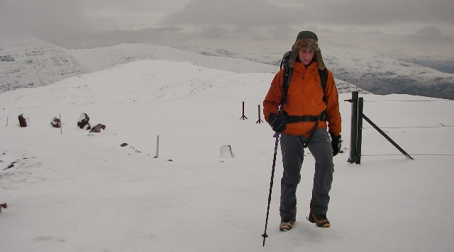 The famous mountaineer pleased to reach his summit of Sgurr a Chaorachain.