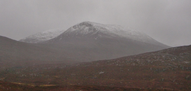Fresh snow line on the north top Beinn Liath Mhor Fannaich (870m)