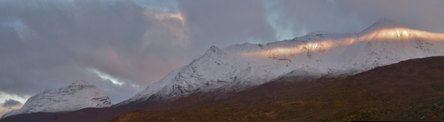 Glompses of early sun on Beinn Eighe (Coire an Laoigh) and Liathach.