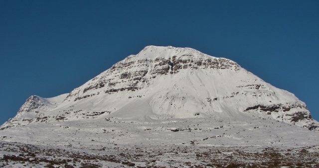 Liathach. Some sun induced single point avalanches start immediately  the ridge and gather to a significant size.